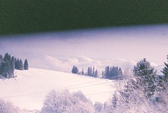 Atmo (seryogig) Tags: blue winter cloud white snow film analog forest canon kodak 52mm