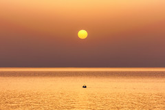First Light (Explored) (Septro) Tags: red orange sun water june sunrise fishing greece solstice crete