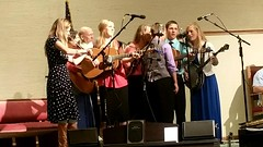 Having fun on stage (The Kingery Family) Tags: family pink blue red music white green mom fun grey dad purple singing baseball bluegrass brothers bass guitar sister group navy smiles mandolin banjo siblings indoors harmony fiddle kingery mic baccalaureate