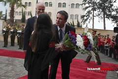 French Prime Minister Manuel Valls receives a flower bouquet as he arrives in Ramallah (TeamPalestina) Tags: heritage photo education photographer natural live palestine westbank ramallah innocent freepalestine photooftheday picoftheday palestinian occupation  issamalrimawi