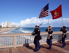Memorial Day (PelicanPete) Tags: usa march waves unitedstates florida outdoor flag shoreline soldiers tribute sunlit memorialday southflorida unitedstatesmarinecorps deerfieldbeachpier
