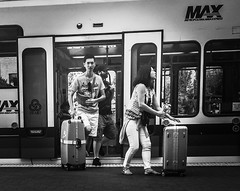 Urban Arrivals (TMimages PDX) Tags: road street city travel people urban blackandwhite monochrome train buildings portland geotagged photography photo image streetphotography streetscene tourists sidewalk photograph pedestrians pacificnorthwest avenue vignette travelers fineartphotography iphoneography