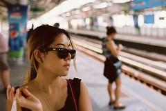 Between Malls (benriley80) Tags: summer hot film girl station shop train thailand 50mm nikon kodak bangkok thai skytrain portra bkk rayban bts 160 f801s thonglor thonglo