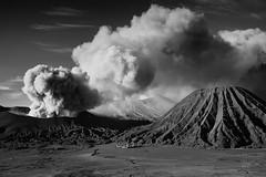 The Eruption of Mount Bromo (eggysayoga) Tags: park blackandwhite bw cloud monochrome 35mm indonesia lens temple java nationalpark f14 east mount fujifilm dust gunung pura fujinon jawa bnw eruption bromo bukit tengger batok jawatimur xt1 meletus erupsi