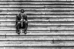 Alone, but with the world in his hands. (PiTiS ~) Tags: street nyc newyorkcity blackandwhite ny newyork byn blancoynegro stairs alone solitario escaleras
