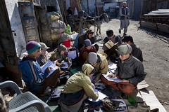 Boys reading books at garbage depot 3587 (shahidul001) Tags: poverty pakistan boy color colour boys horizontal kids children reading book daylight kid garbage asia day child refugee refugees homeless poor books read pakistani deprived garbagepicker drik southasia indigent quetta garbagepickers garbagedepot drikimages