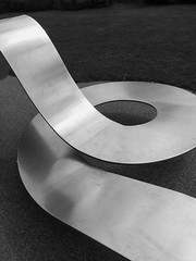 Have a seat (dawn_macroart) Tags: salfordquays seatingarea modern abstract arty bw form shape curves metal shadow lettere