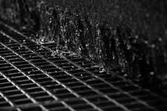 Grid (D [Red] Photography) Tags: blackandwhite white canada black macro fall water monochrome metal canon grid mono waterfall drops exposure edmonton zoom july run drop drain drip alberta freeze frame shutter droplet legislature 14000 runoff yeg 2013 t1i
