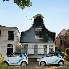 Modern mobility in a historical part of Amsterdam (Bn) Tags: auto old city blue camping houses windows summer white caf smart car amsterdam electric modern boat