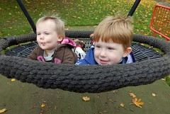 Megan & Jack in full swing (Shamus O'Reilly) Tags: park uk baby face playground children jack bath funny megan swing actionshot royalvictoriapark