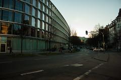 Neighborhood [Munich] (Melvinia_) Tags: street winter light sunset reflection building glass canon buildings munich mnchen bayern bavaria strasse january neighborhood 1855mm rue reflets westend ver