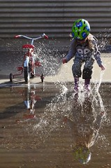 Splish Splash, I was Taking a Bath! (Vegan Butterfly) Tags: playing cute water fun puddle outside outdoors person kid vegan child play helmet adorable splash splashing