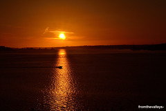 Speedboat across the sunset (fromthevalleys-) Tags: sunset westwales sundown speedboat pembrokeshire magichour milfordhaven pembrokedock