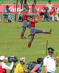 The media may be interested but the policeman is not impressed by the goosestepping... (10b travelling / Carsten ten Brink) Tags: sports festival uniform asia wrestling mongolia national policeman ulaanbaatar 2012 mongolei naadam goosestep carstentenbrink iptcbasic