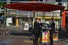 Early Evening Chat, Wittenbergplatz, Berlin (westport 1946) Tags: berlin germany deutschland postbank cycle cocacola takeaway canopies wittenbergplatz bluepipe bayreutherstr