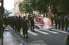 """We go to great lengths to protect the citizen"" (CristianKlen) Tags: brazil film me riodejaneiro analog 35mm 50mm fuji rj pentax superia protest police super 400 pm smc xtra manifestação f17 policiamilitar pentaxm"