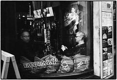 The Taco Bar (stejo) Tags: leica window bar stockholm relaxing taco hp5 streetphoto gamlastan oldtown m6 leicam6 västerlånggatan zeiss35biogon