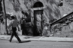 Street 121 (`ARroWCoLT) Tags: street door light shadow bw white house man black monochrome wall stairs underground walking photography blackwhite gate shadows grafiti walk low ruin samsung istanbul line age f2 beyaz heybeliada mid harabe sokak irongate siyah midage nx300