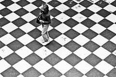 woman in the square // prague (Das halbrunde Zimmer) Tags: street city urban bw architecture canon square 50mm europa europe prague streetphotography prag artnouveau stadt schwarzweiss blackandwhitephotography