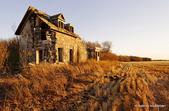Halfway Gone [Explored] (/ shadows and light) Tags: old november house abandoned grass stone countryside warm decay manitoba abandonment decayed decaying stubble ruralexploration rurex fallcolorsfallcolours nearpurves
