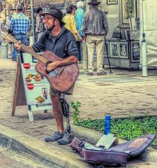 Keep a Song, Don't Give Up (clarkcg photography) Tags: music sunshine guitar song strings streetmusic goodtimes hardtimes cloudyday dontgiveup flickrfriday garyreid keeppushing