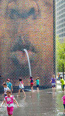 Crown Fountain . . . (Dr. Farnsworth) Tags: chicago playing art water glass pool mouth children spring faces spray il tall millenniumpark crownfountain may2016