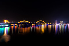The Nam 022 (Cycle the Ghost Round) Tags: city urban orange reflection water night river view symbol landmark vietnam danang hanriver dragonbridge caurong