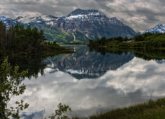 Storm Coming... (Ruth Voorhis) Tags: mountains lake clouds reflections trees foliage sky