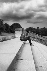 Followed by a dark cloud (EyeOfTheLika) Tags: park street trees sky bw woman cloud white storm black london art rain clouds stairs dark crystal side profile perspective streetphotography palace lika lonely stress motivational 500px ifttt