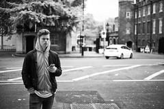 Waiting (Foto John) Tags: leica uk blackandwhite man london monochrome youth blackwhite streetphotography rangefinder leicam summicronm35mmf2asph leicam240 blackandwhitethatsright