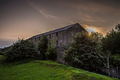 Derelict Mill at Sunset (deltic17) Tags: sunset urban building mill evening urbanexploration abandonded ghostly derelict