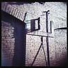 Holga - brick wall - img101 (T. Brian Hager) Tags: shadow brick 120 film wall square holga 120film epson bethlehem bethlehempa holgagcfn epsonv600