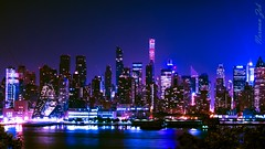 NYC Metropolis (a2roland) Tags: new york city nyc blue ny reflection water colors skyline night buildings river lens landscape lights photo nikon glow zoom branches picture norman late metropolis hudson tall chrysler metropolitan flicker zeb a2rolandyahoocom