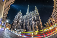Gothic with sparkles (Pietro Faccioli) Tags: vienna street city travel windows sky urban building tower church monument architecture night buildings square stars lights austria town ancient downtown exterior cathedral gothic perspective trails landmark stephen trail belfry historical stephansdom oldtown starry romanic pietro faccioli pietrofaccioli