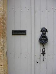Old door, Vzelay (toucanne) Tags: door stone iron paint porte doorknocker latch