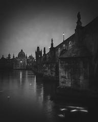 Gothic (Vesa Pihanurmi) Tags: charlesbridge dawn bridge prague praha lanterns lamppost statues sculpture tower spires cityscape karlvmost monochrome blackandwhite vltava river swans dark mifa moscow2016