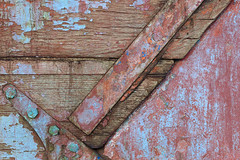 Macro Texture Study 6 (katie47n) Tags: macro boat hull peelingpaint rust texture detail abstract wood old wickford ri color weathered worn shipyard boatyard