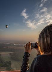 Here he comes (PMTN) Tags: sky woman portugal colors clouds sunrise canon cores mulher balloon balo cu nuvens nascerdosol coruche pedronascimento