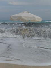 Waves in grey (Wider World) Tags: storm beach umbrella greece kefalonia kephalonia cephalonia ionian
