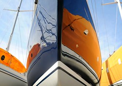 Boat 166 (floralgal) Tags: abstract reflections boat bow nautical hull sailboats masts boatreflections boatabstract