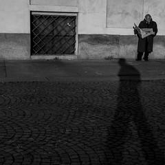 Stampa e Regime (PegaPPP) Tags: shadow italy news persona reading newspaper democracy italia ombra marcia uomo sole sanpietrini lettura regime passo giornale stampa