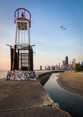 Feels Like Summer (Chris Smith/Out of Chicago) Tags: light lighthouse chicago hancockbuilding skyline sunrise graffiti seagull seawall pinksky northavenuebeach 17mmtiltshift