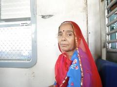 RAJASTHANI MAMTA (RubyGoes) Tags: blue red india train gold bombay maharashtra mumbai