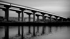 Twin Bridges (ChuckanutQuirks) Tags: bridge bw blackwhite diagonal skagit engineeringasart swinomishchannel rx100 reflectivewater bwgallery ennoiretblanc artinblackandwhite bridgesinblackandwhite northwestelements bwtheworldinblackandwhite artisticperspectives dscrx100 sonyrx100 sonycybershotrx sonydscrx100 sonycybershotrx100rx100ii monogroupfor50 bridgesofthepacificnw artofmonochrome