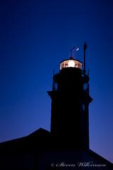 Beavertail Silhouette (Wilks2010) Tags: lighthouse silhouette rhodeisland slowshutter beavertail bluehour