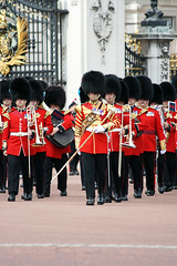 Changing Of The Guard (violinconcertono3) Tags: uk red men heritage history hat musicians army uniform europe surveillance traditional unity rifle ceremony kingdom security visit buckinghampalace journey change changingform protection groupofpeople gravel armedforces traditionalculture caucasian honorguard londonengland trooping groupofobjects colorimage famousplace shielding bearskinhat europeanculture