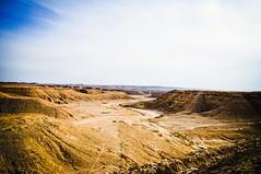 Alleys & Valleys  ... The Mighty Desert (Hazem Hafez) Tags: travel sunset sun desert hills cracks harsh valleys