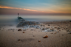 Low tide at Hove (Andr Jardinire) Tags: longexposure sunset sea beach canon prime sussex golden sand hove pebbles groyne 22mm eosm mirrorless