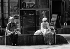 What did I say (Nikonsnapper) Tags: street bw couple candid cardiff olympus unposed zuiko omd separate em1 1240mm