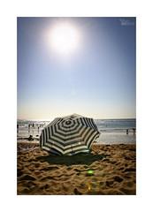 Playeando... (ngel mateo) Tags: sun sol beach umbrella contraluz sand playa arena backlit sombrilla cantabria suances playadetagle ngelmartnmateo ngelmateo